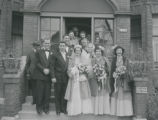 Wedding party posing on steps