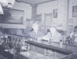 Two men enjoying drinks at a bar
