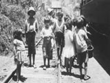 Children on railroad tracks in Costa Rica
