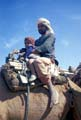 Man and child on camel, Palestine