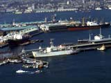 Cargo ships and boats in harbor, Tokyo, Japan