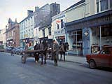 Horse-drawn cart on street in Ireland