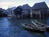 Boats and stilt houses in Penang, Malaysia