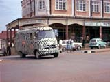 Safari bus on street in Uganda