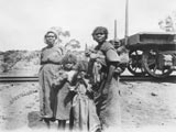 Women posed near train, Australia