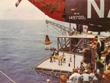Spacecraft being lifted from Pacific Ocean by USS Kearsarge CVS-33
