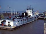 Towboat and barge in lock on the Mississippi river in Alton, Illinois