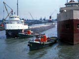 Tugboats and cargo boats on the Calumet river in Chicago, Illinois