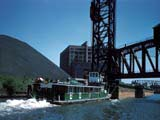 Barge tow under railroad bridge on Chicago River, Chicago, Illinois