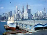 Cargo boats docked  in East River, New York, New York (1962)