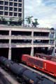 Freight train crossing under parking ramp in Vancouver, Canada