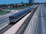 Passenger train alongside highway in Chicago, Illinois