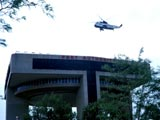 Helicopter landing on building platform in New York, New York
