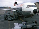 DC-10 airplane loading in airport, Seattle, Washington