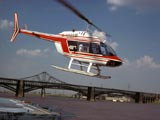 Helicopter in flight near bridges in St. Louis, Missouri