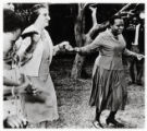 1960: Golda Meir dancing with Mrs. Jomo Kenyatta in Kenya