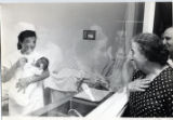 1970: Golda looking at a newborn at a hospital