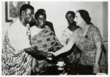 Golda Meir shaking hands with visiting African diplomats
