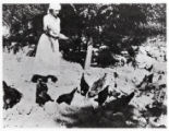 1921: Golda Meir feeding chickens in a settlement in Merhavia