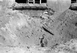 Warsaw bombing in September 1939, bomb crater next to an apartment building