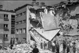 Warsaw bombing in September 1939, civilians cleaning debris from a destroyed apartment building