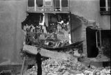 Warsaw bombing in September 1939, child in front of destroyed apartment building