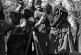 Boy lama looking through Harrison Forman's movie camera