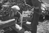 Two men splitting wood in Chengde