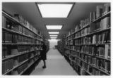 Library user perusing book at Golda Meir Library