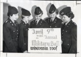 ROTC cadets holding up a sign for the Military Ball