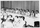 Faculty and graduates at senior dinner in 1953