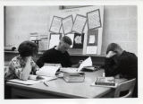 Students studying in Mellencamp Hall Library