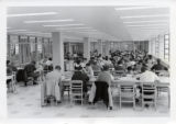 Students at study tables in Mellencamp Hall Library