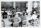 Students studying in the Library in Mellencamp Hall