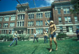Students playing volleyball in front of Mitchell Hall