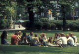 Students sitting on a campus lawn