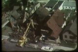 News film clip (partial) showing damaged buildings, the Milwaukee Police and the National Guard on...